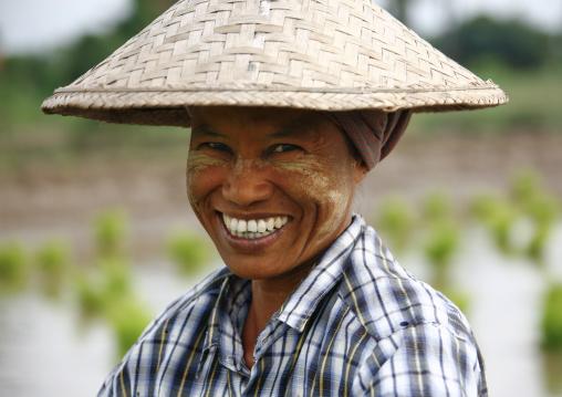 Smiling Woman With Asian Hat In Innwa, Myanmar