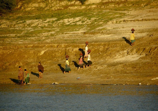 Women Collecting Water On Irrawaddy River Banks, Myanmar