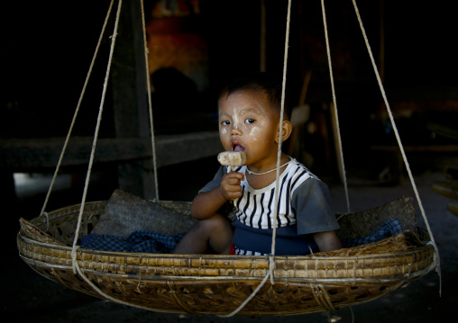 Baby In A Craddle Eating An Ice Cream, Bagan, Myanmar