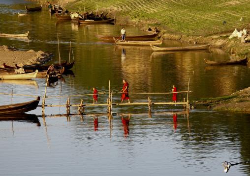 Buddhist Monks Crossing A Bridge, Bagan, Myanmar