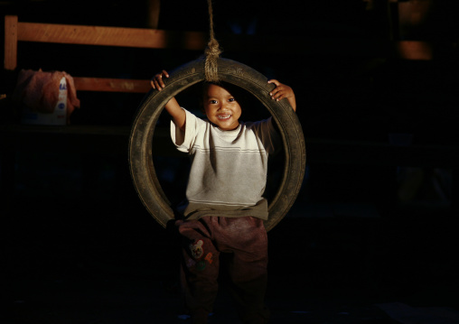 Kid playing with a tyre, Bagan, Myanmar