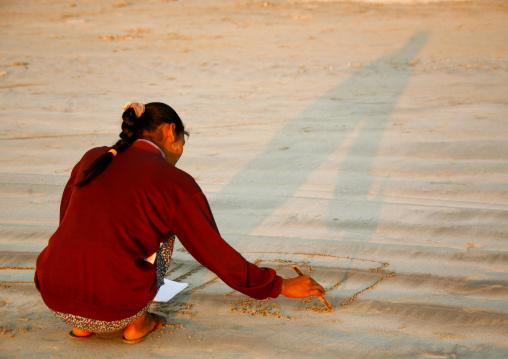 Student Doing School Execices On Sand, Ngapali, Myanmar