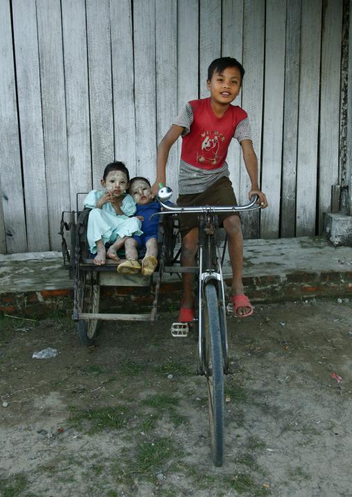 Kids playing with a rickshaw, Ngapali, Myanmar