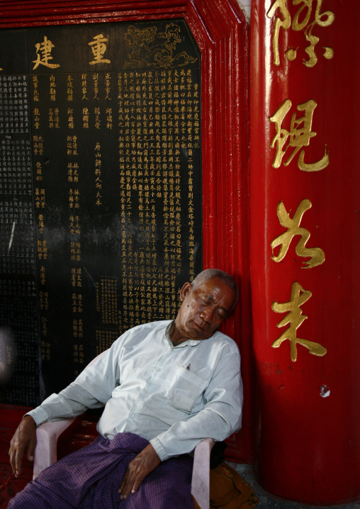 Man sleeping in a chinese temple, Rangoon, Myanmar
