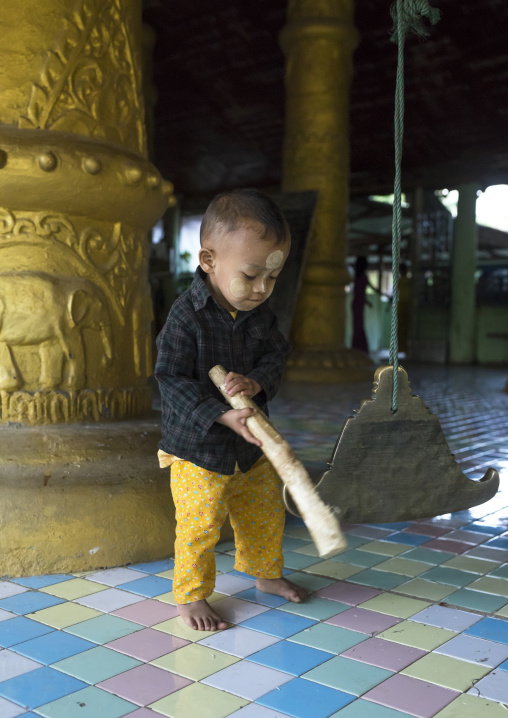Litlle Boy Ringing A Bell In A Temple, Mrauk U, Myanmar