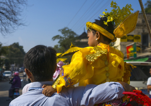 Child and father during a novitiation parade, Bagan,  Myanmar