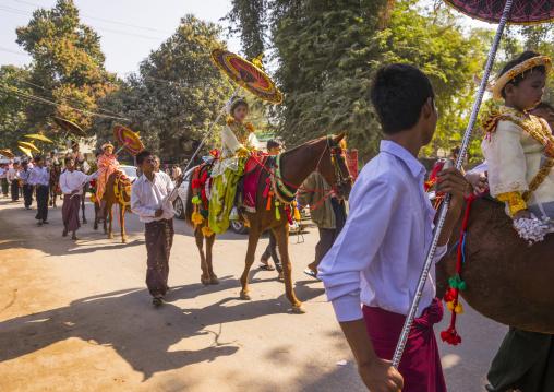 Novice children riding horses for the novitation parade, Bagan,  Myanmar
