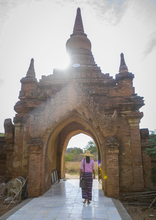 Woman Going Out Of An Old Temple Gate, Bagan, Myanmar