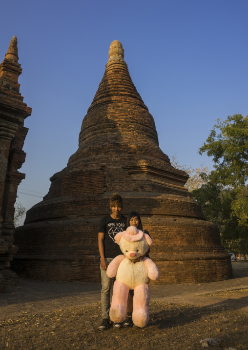Young Couple In  Front Of An Old Temple, Bagan, Myanmar