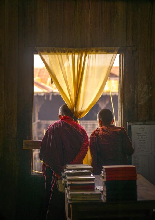 Novices Monks Looking Thru A Window, Inle Lake, Myanmar