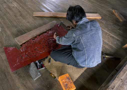 Man making a decoration for a temple, Inle lake, Myanmar