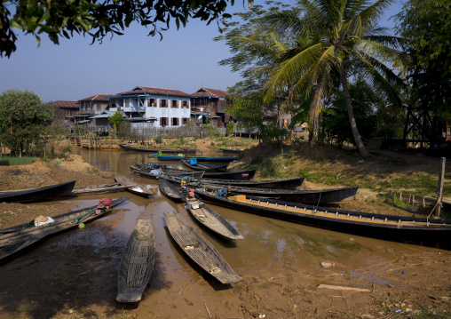 Boats On Banks In Front Of A Huge House, Inle Lake, Myanmar