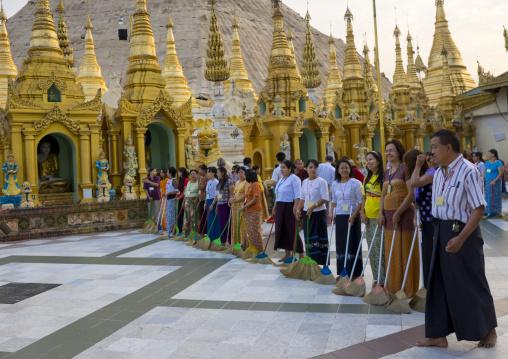 Women And Men Sweeping The Shwedagon Pagoda, Yangon, Myanmar