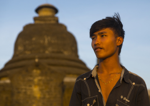 Brumese Man In Front Of A Buddhist Temple, Mrauk U, Myanmar