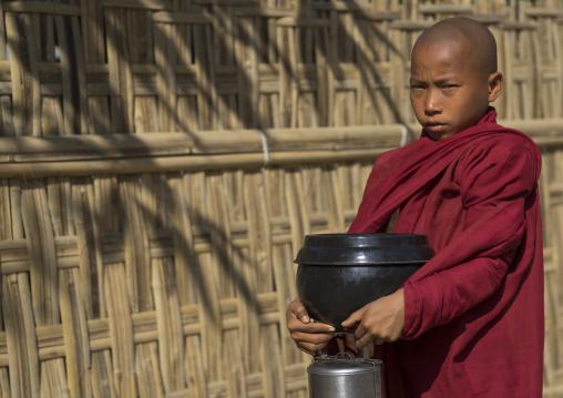 Novice Monk Begging For Food On A Road, Mrauk U, Myanmar
