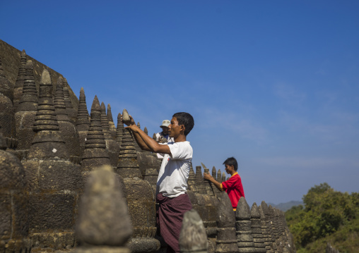 Men Restoring Stupas At Kothaung Temple, Mrauk U, Myanmar