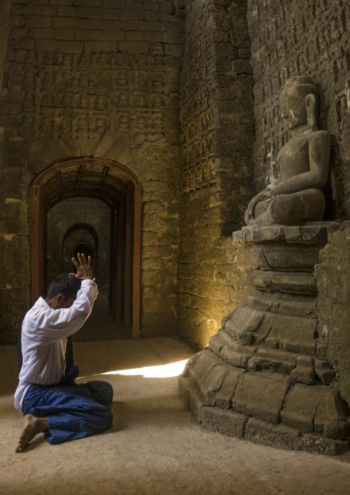 Man Praying Inside Kothaung Temple, Mrauk U, Myanmar