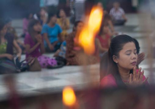 People praying at the shwedagon pagoda, Yangon, Myanmar
