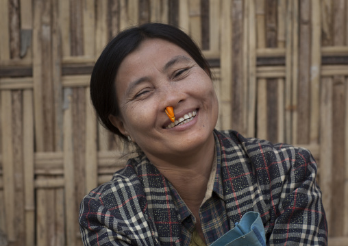 Woman With Orange Peel In The Nose To Bring Freshness, Mrauk U, Myanmar