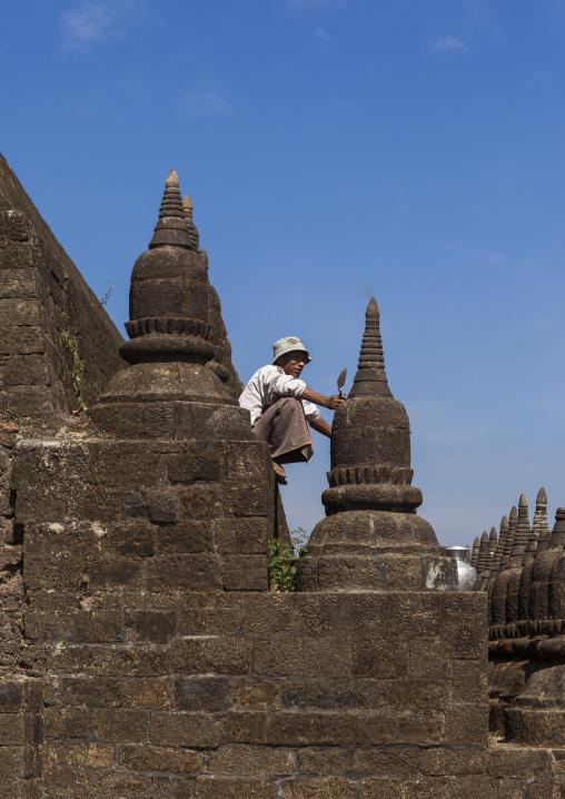 Man Restoring Kothaung Stupas, Mrauk U, Myanmar