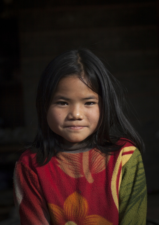 Young chin girl with thanaka on the face, Mindat, Myanmar
