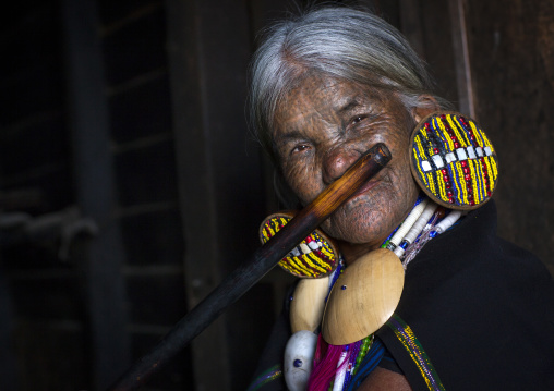 Yun eian from magan tribe playing nose flute, Mindat, Myanmar