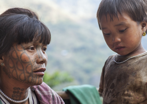 Tribal Chin Woman From Muun Tribe With Tattoo On The Face With Her Daughter, Mindat, Myanmar