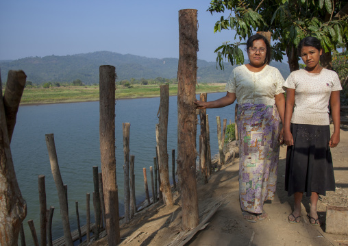 Rohingya women in front of a river, Thandwe, Myanmar