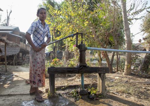 Rohingya Girl Pumping Water, Thandwe, Myanmar