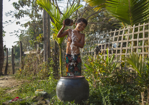 Rohingya Child Having A Bath, Thandwe, Myanmar