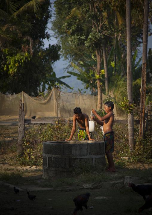 Rohingya Children In Front Of The Village Well, Thandwe, Myanmar