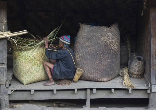 Old chin man making a basket, Mindat, Myanmar