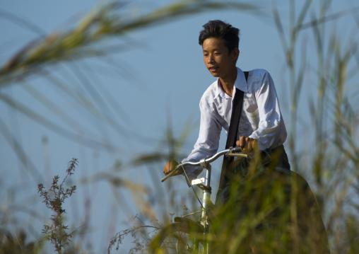 Boy Riding A Bicycle On The Banks, Inle Lake, Myanmar