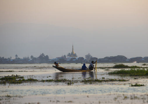 Traditional Fisherman With Fish Trap In Boat, Inle Lake, Myanmar