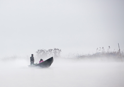 Tourists In The Fog On A Boat Tour, Inle Lake, Myanmar