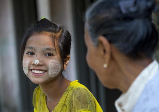 Girl With Thanaka On Cheeks And Her Gradn Mother, Ngapali, Myanmar