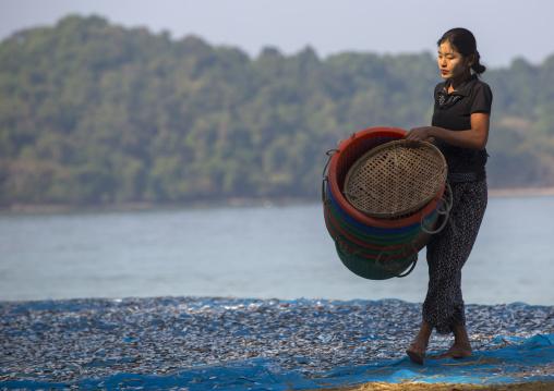 Woman Putting Dried Fish On The Floor, Ngapali, Myanmar