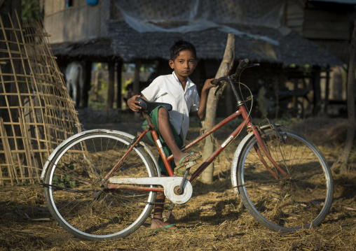 Rohingya boy with his bike, Thandwe, Myanmar