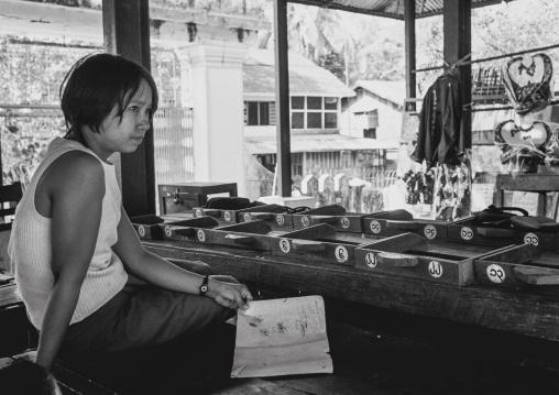 Girl Taking Care Of Temple Restooms In Yangon, Myanmar