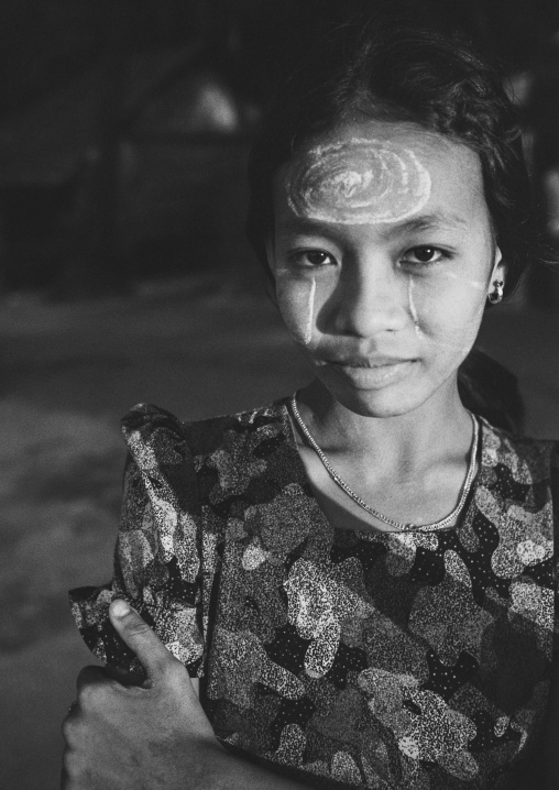 Burmese young woman with thanaka on her face, Ngapali, Myanmar