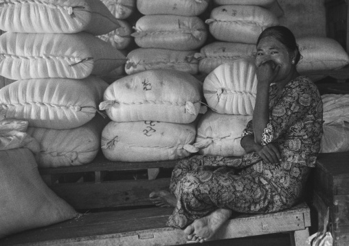 Women sit in front of bags in a market, Ngapali, Myanmar