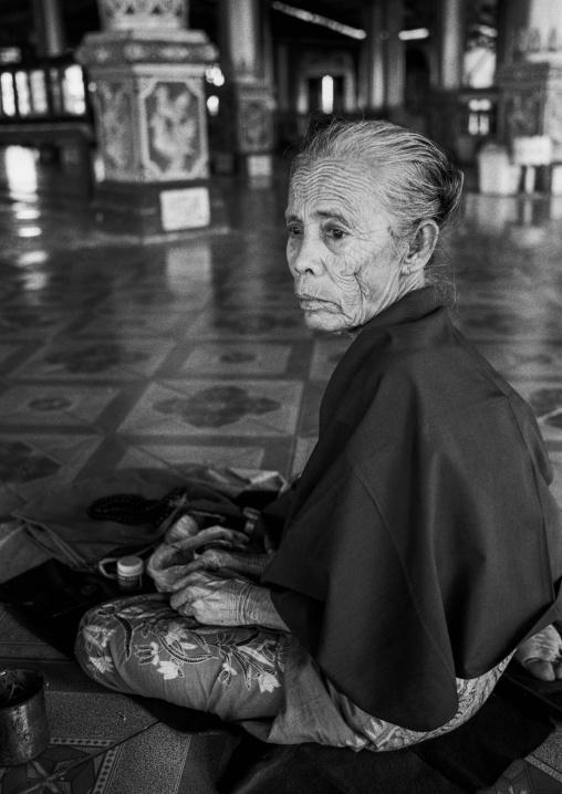 Old Burmese Woman In A Temple, Yangon, Myanmar