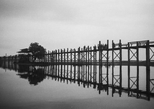 People crossing u bein bridge in amarapura, Mandalay, Myanmar