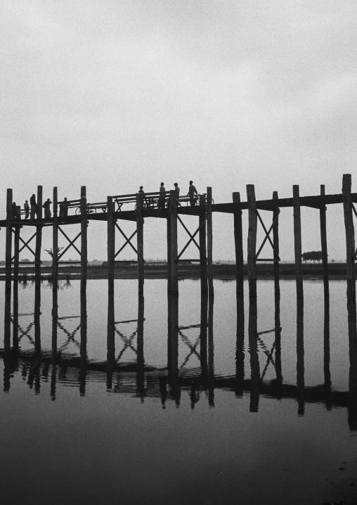 People Crossing U Bein Bridge In Amarapura, Mandalay, Myanmar