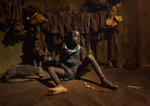 Young Himba Girl With Ethnic Hairstyle In Her Hut, Epupa, Namibia