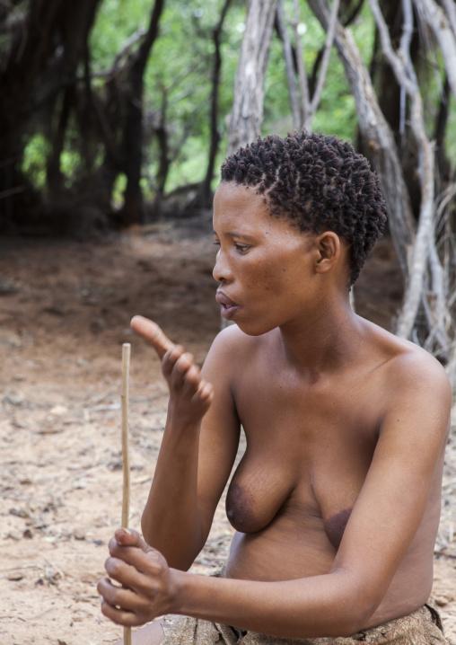 Bushman Women Making Necklaces With Ostrich Egg Shell, Tsumkwe, Namibia