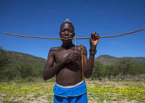 Himba Man Playing Bow Instrument, Epupa, Namibia