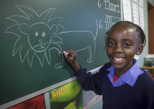Girl Drawing A Lion In Africat Foundation School, Okonjima, Namibia