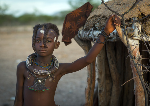 Girl Of Hima Tribe Standing In Door Of Shack, Epupa, Namibia