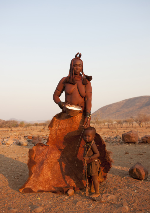 Himba Child In Front Of A Skin Holding His Mother S Hand, Okapale Area, Namibia